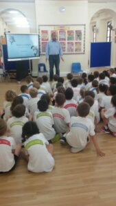 Year 2's receive a talk ending on the importance of recycling !